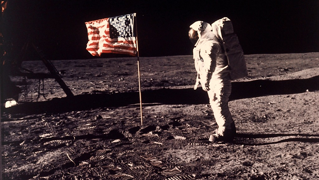 Astronaut Buzz Aldrin poses for a photograph beside the U.S. flag deployed on the moon during the Apollo 11 mission on July 20, 1969.  (Neil A. Armstrong/NASA via AP, file)