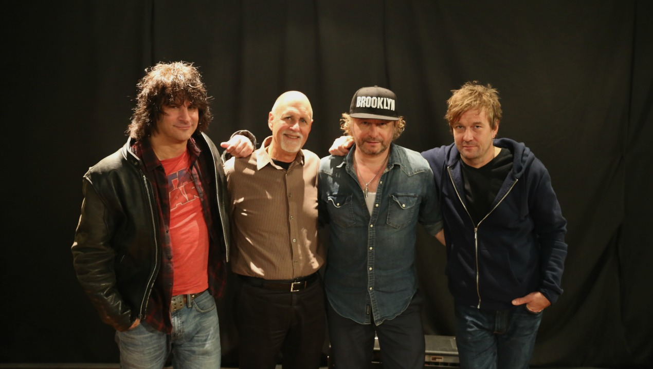James Maddock (in cap) with his trio and John Platt (photo by Jeremy Rainer/WFUV)