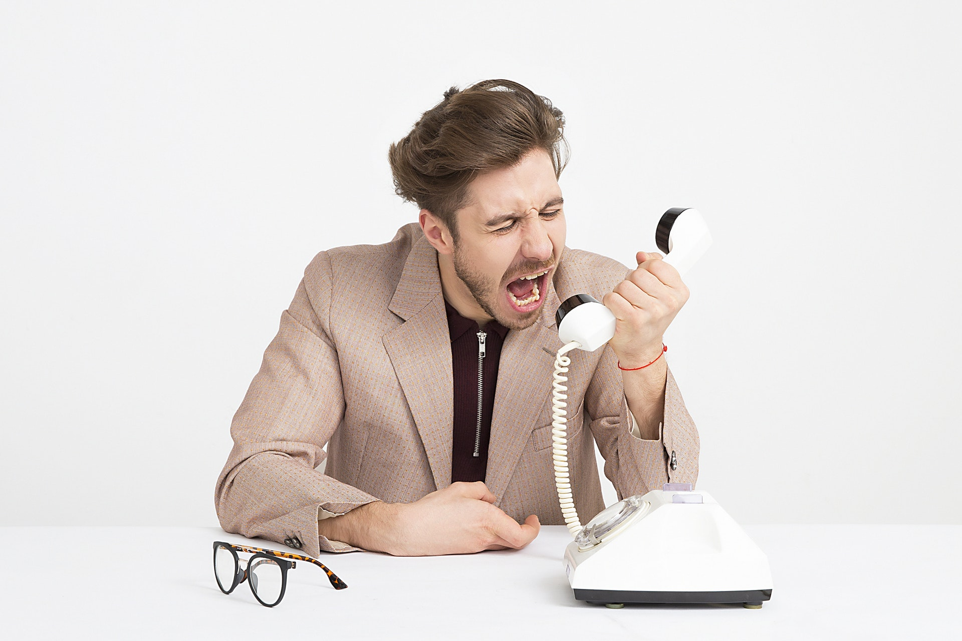 Angry Adult yelling at phone
