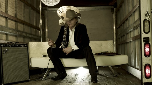 Talking about '3 Pears' and more, hear Rita Houston's tour bus chat with Dwight Yoakam, tonight at 9 on Words & Music.