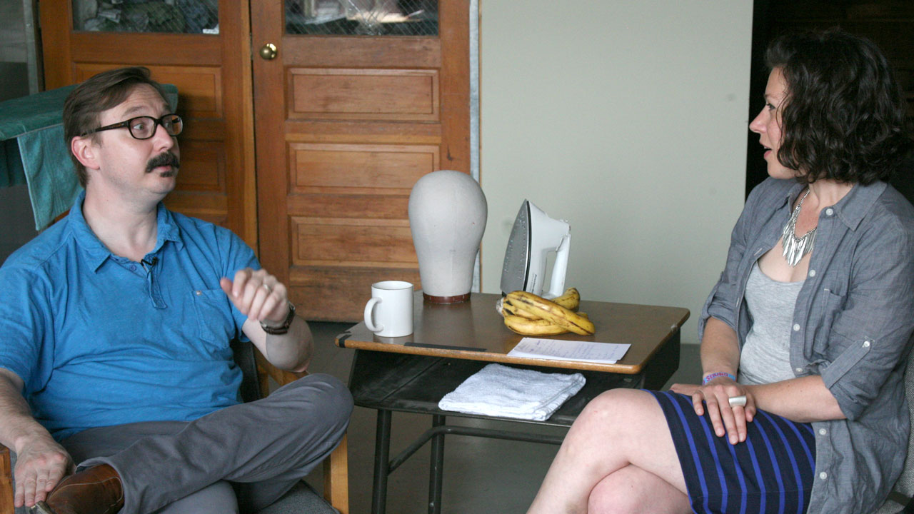 Comedian/actor/concert host John Hodgman talks with Carmel Holt backstage at Solid Sound.