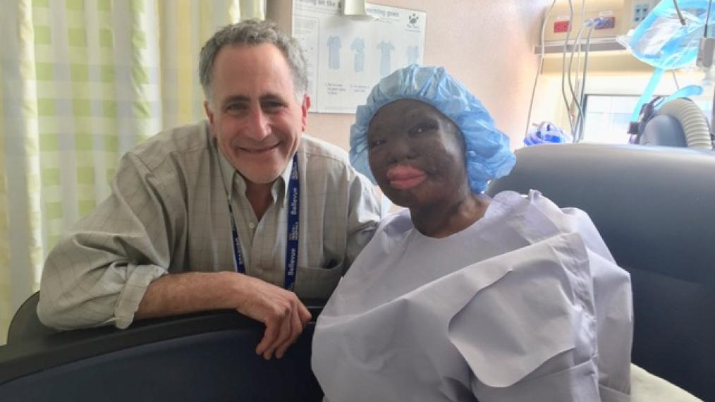 Hawa, a Haitian refugee, just finished surgery.