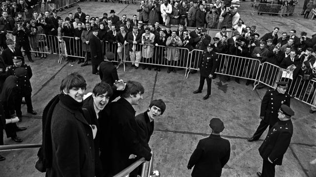 """The Beatles deplaning at JFK (photograph by Harry Benson, from the LIFE book, """"Paul McCartney"""")"""