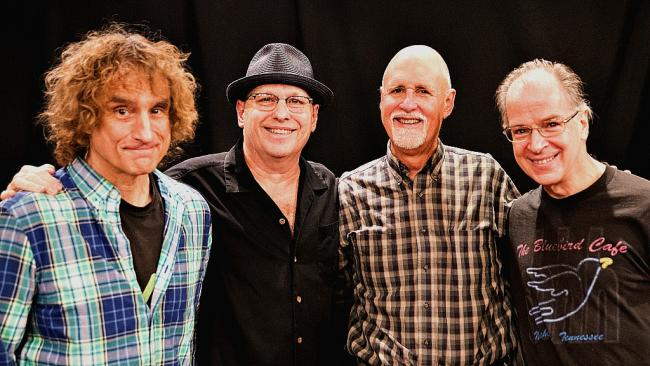 """Bruce T. Carroll (with hat) and his bandmates joined by """"Sunday Supper"""" host John Platt (photo by Jeremy Rainer)."""