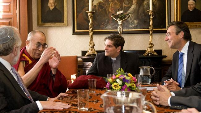 The Dalai Lama speaks during a meeting with Dutch minster of foreign affairs Maxime Verhagen Rabbi Awraham Soetendorp and priest Ad van der Helm in The Hague, Netherlands, Friday June 5, 2009.