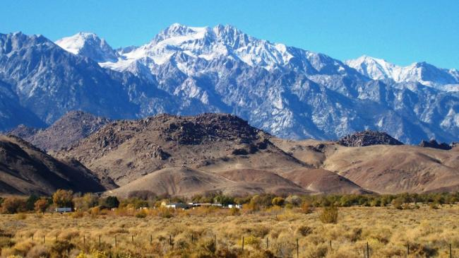 Low-lying Alabama Hills in front of the snow-capped eastern Sierra Mountains near Lone Pine, CA