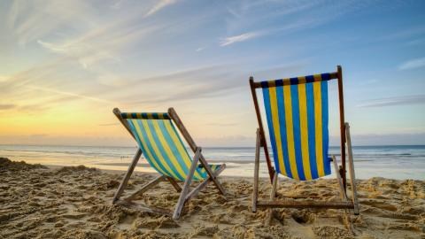 "Beach, chairs and sun. (""A Nice Place to Sit"" by Richard Walker, courtesy of CC 2.0)"