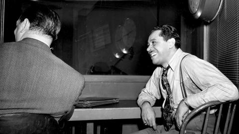 Cab Calloway in the control room listening back to a playback of a March 1947 recording with his orchestra at Columbia Studio (AP Photo)