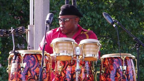 Chris Polk band conga and bongos drummer