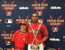 Yoenis Cespedes and Nate Johnson of the Duluth Boys and Girls Club