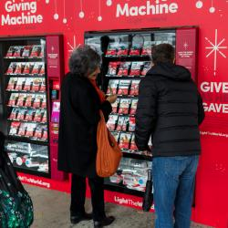 People make donations using Giving Vending Machines at Lincoln Center