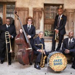 Ben Jaffe, center on double bass, and the Preservation Hall Jazz Band (photo by Danny Clinch, PR)