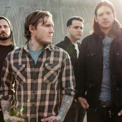 The Gaslight Anthem, Brian Fallon in the foreground (photo by Danny Clinch, PR)