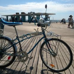 Vintage bicycles gleam in the Coney Island sun.