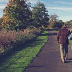 old-couple-walking-path